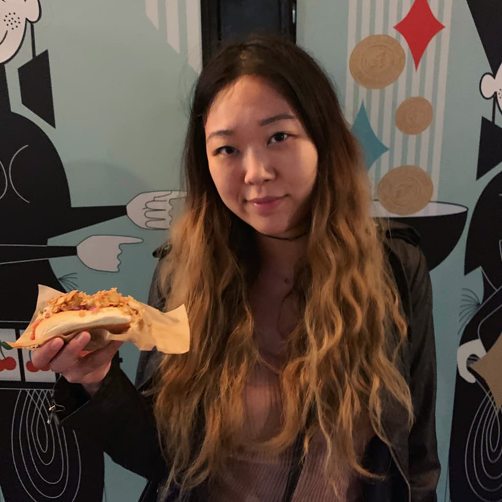 Girl holding hot dog