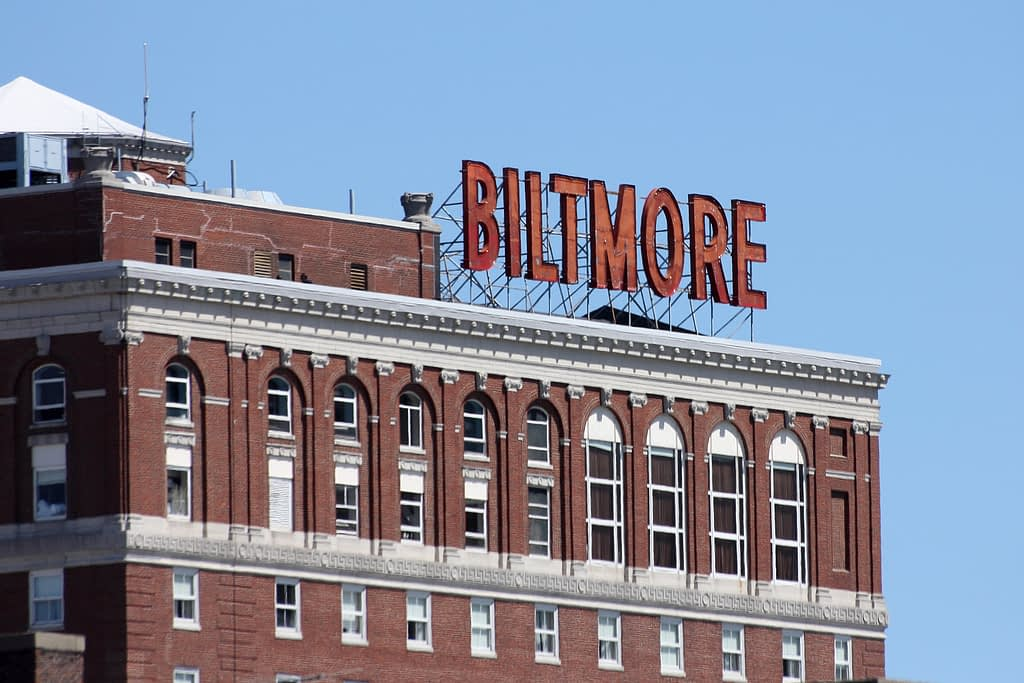 Close-up of red Biltmore sign on top of brick building