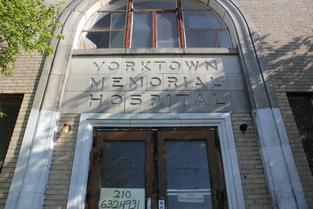 Entrance of tan building which reads Yorktown Memorial Hospital