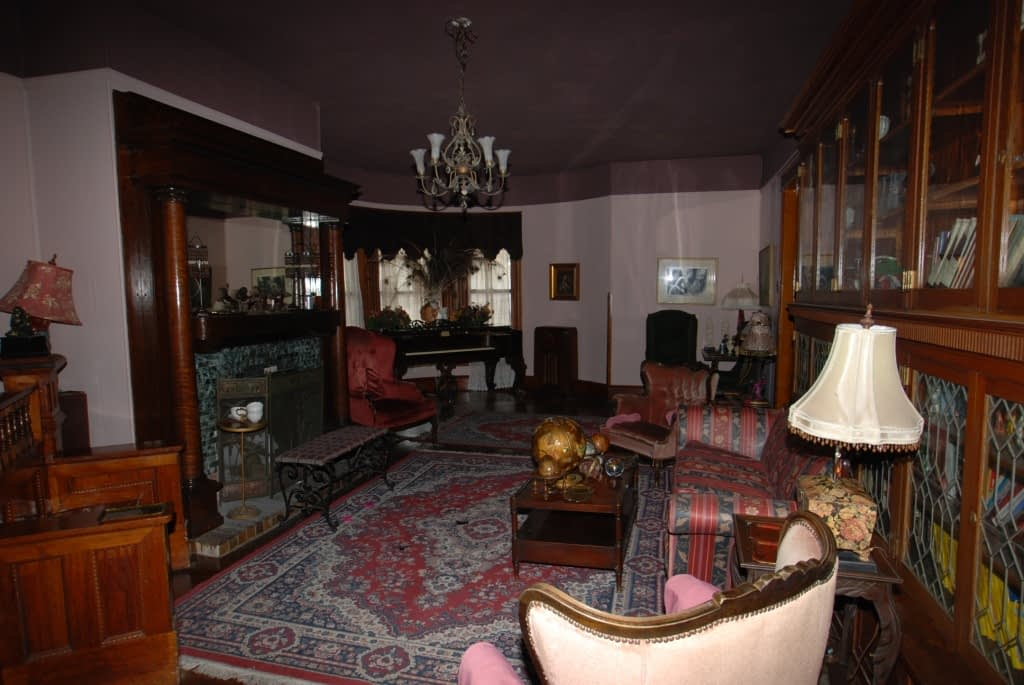 Dark interior of inn, purple and red old-fashioned decor