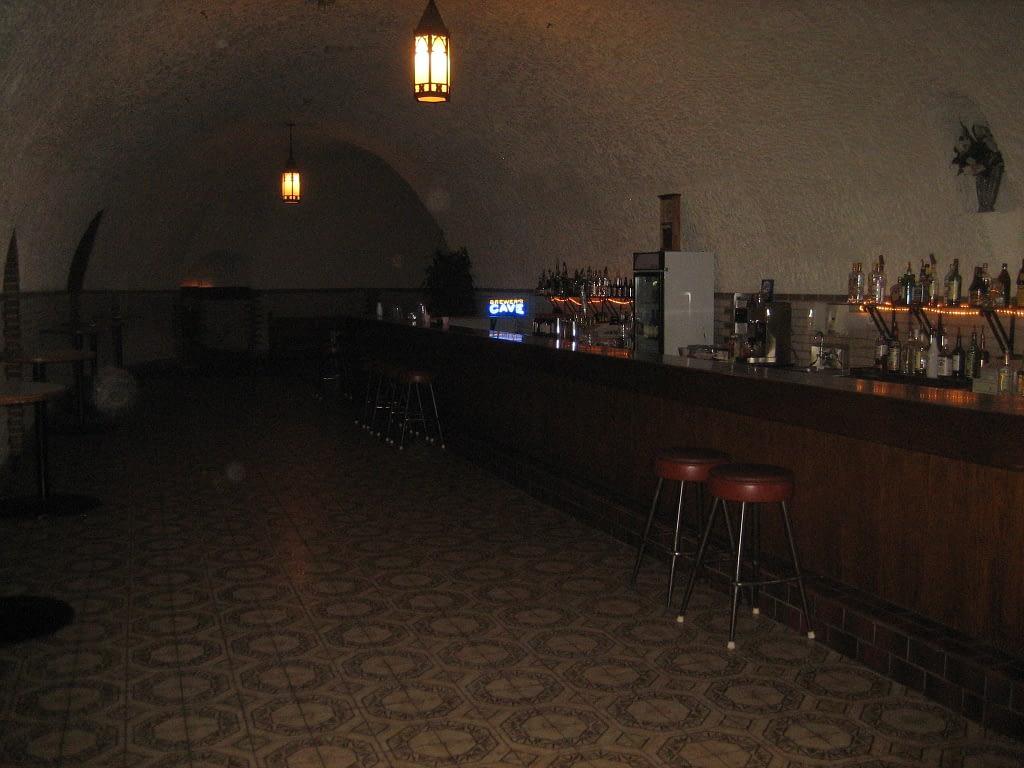 Dark bar inside a cave, patterned tile flooring