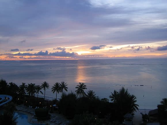 Purple sunset over the water in Saipan, taken from a high vantage point